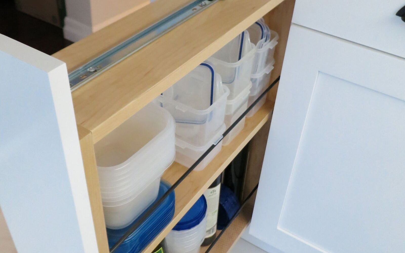 s 31 storage hacks that will instantly declutter your kitchen, Turn a filler panel into a pull out cabinet