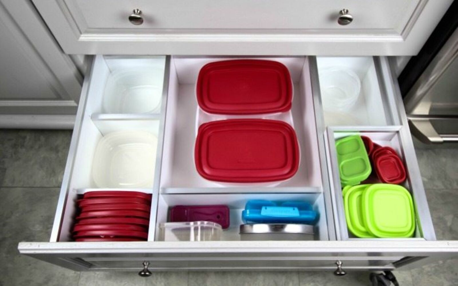 s 31 storage hacks that will instantly declutter your kitchen, Turn your drawers into organizers