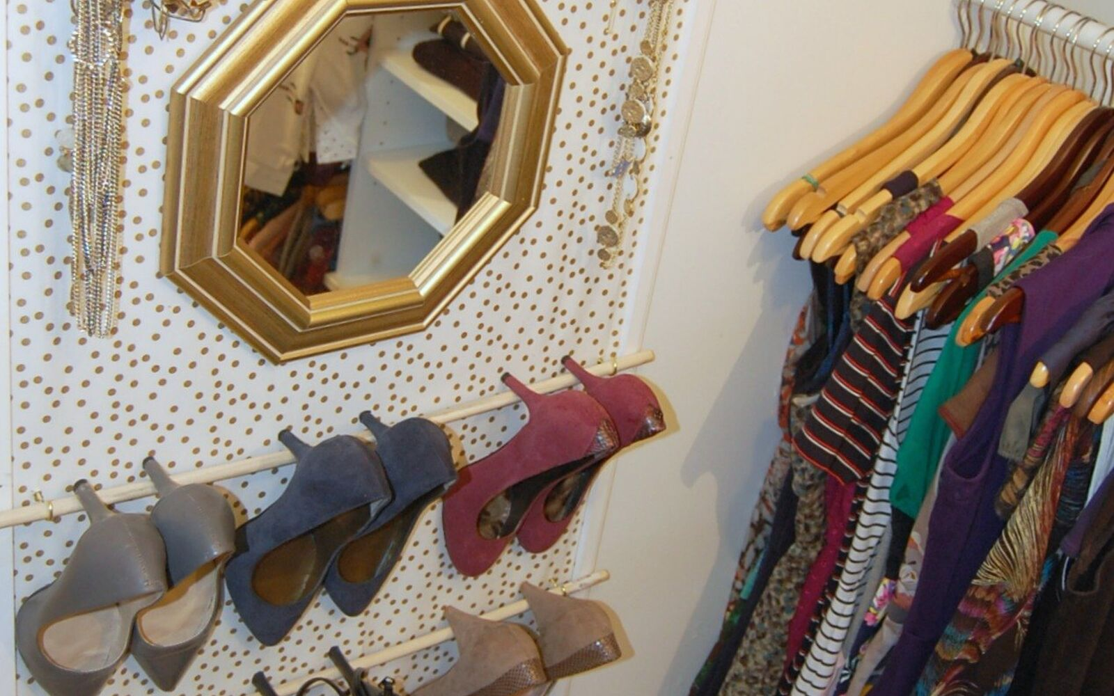 s 32 space saving storage ideas that ll keep your home organized, Put up a vertical organizer in your closet