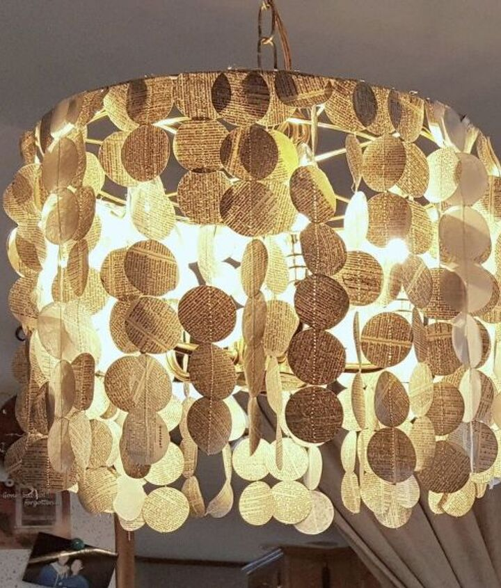s 15 uncanny hacks for making pretty garland decor, Cut Up Your Book Into A Garland Chandelier