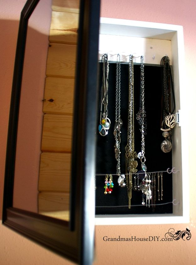 s 30 jewelry organizing ideas that are better than a jewelry box, This hidden jewelry cabinet with a mirror