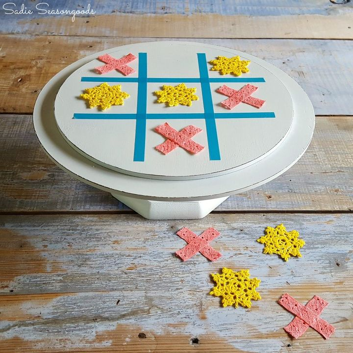 s 30 brilliant things you can make from cheap thrift store finds, Repurposed wooden cake stand to tic tac toe