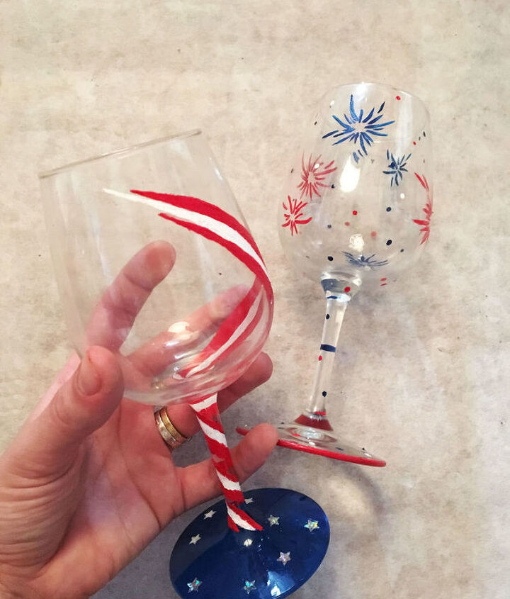 s 30 adorable diy ideas for july 4th, Paint wine glasses with bursts of fireworks