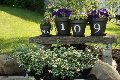 s 30 address signs that ll make your neighbors stop in admiration, Showcase them across a row of flower pots