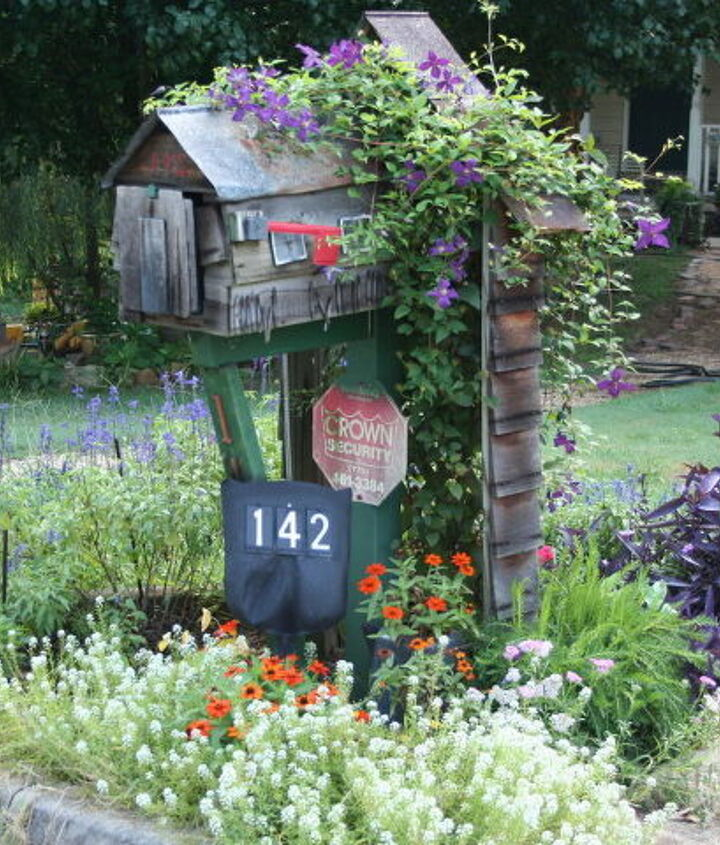 s 30 address signs that ll make your neighbors stop in admiration, Upcycle an old shovel handle to add charm