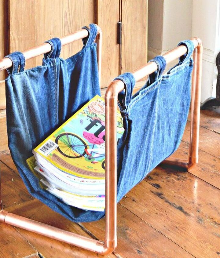 s 30 ways to use old jeans for brilliant craft ideas, Use Jeans And Copper Pipes To Hold Magazines