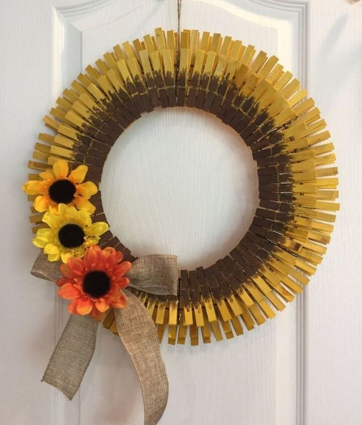 s 30 fabulous wreath ideas that will make your neighbors smile, Make a sunflower from clothespins