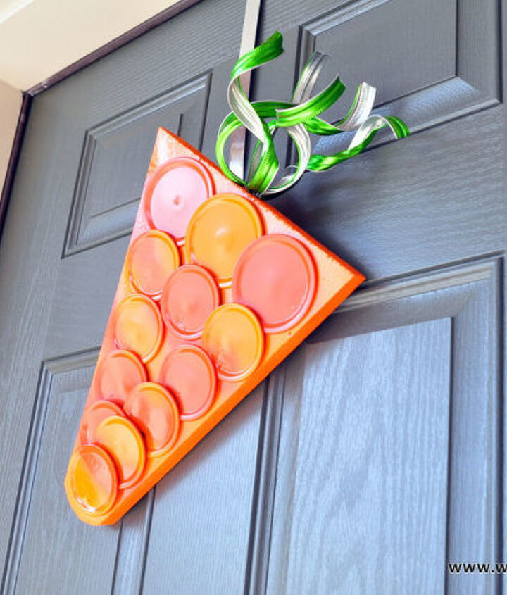 s 30 fabulous wreath ideas that will make your neighbors smile, Create a fun carrot hanger from canning lids
