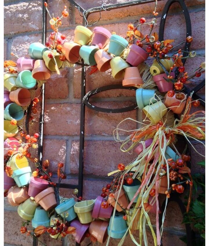 s 30 fabulous wreath ideas that will make your neighbors smile, Connect mini terra cotta flower pots