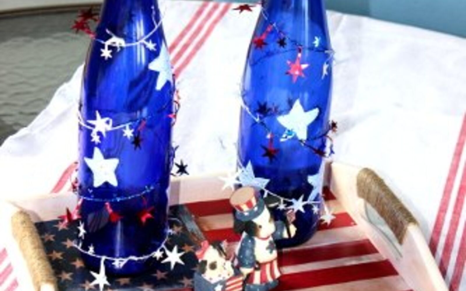 s 10 patriotic projects perfect for your fourth of july party, Wrap Tinsel On Wine Bottles