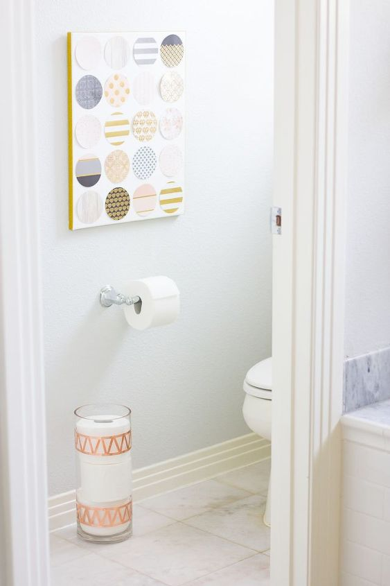 turn a glass vase into chic toilet paper storage