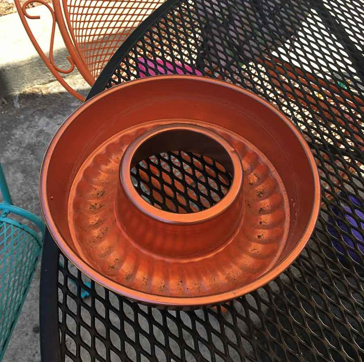 an old copper jello mold gets a new use in the backyard