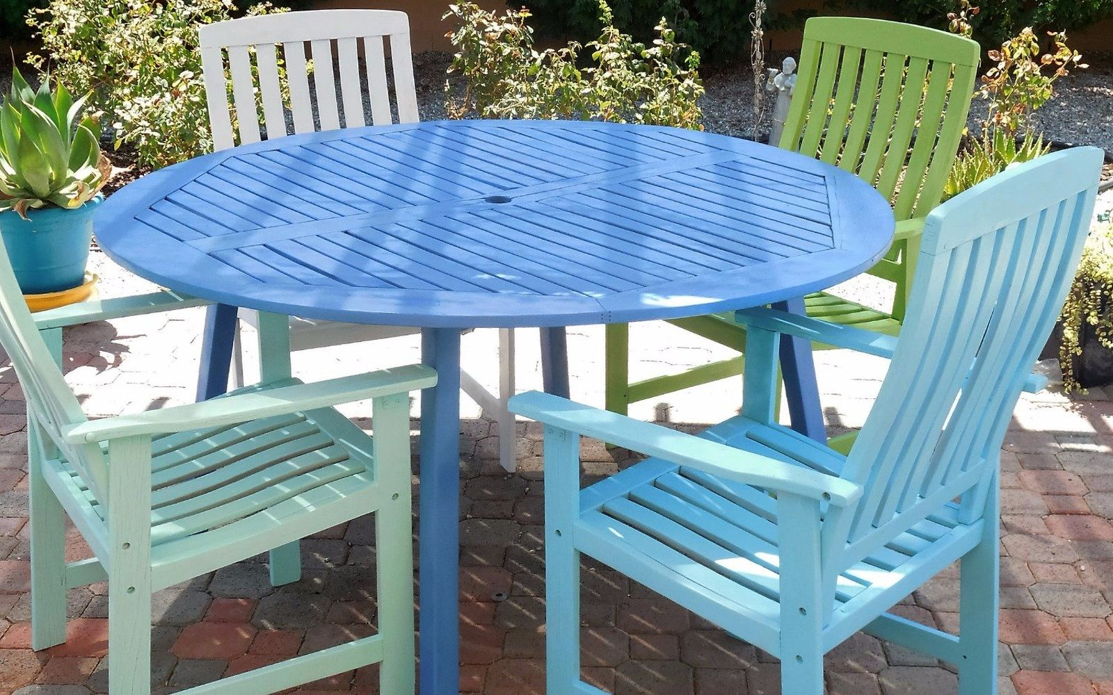 s 15 decorative ways your family can pretty up your patio, Paint Multicolored Chairs For A Table