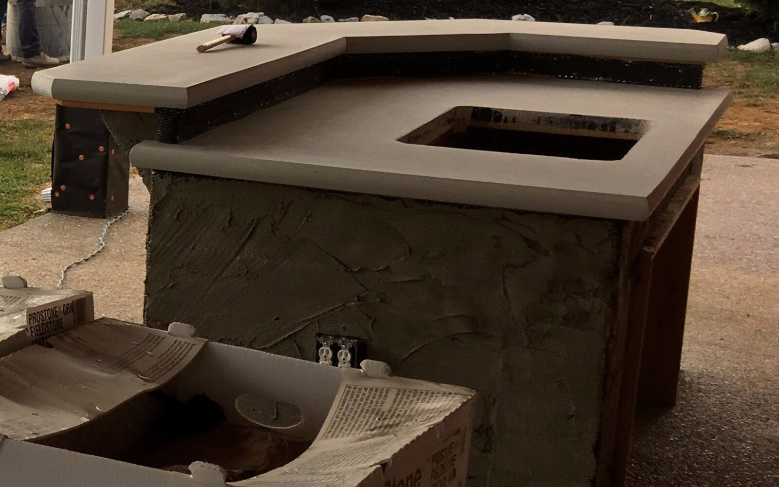 s 15 decorative ways your family can pretty up your patio, Serve Drinks At A Concrete Bar