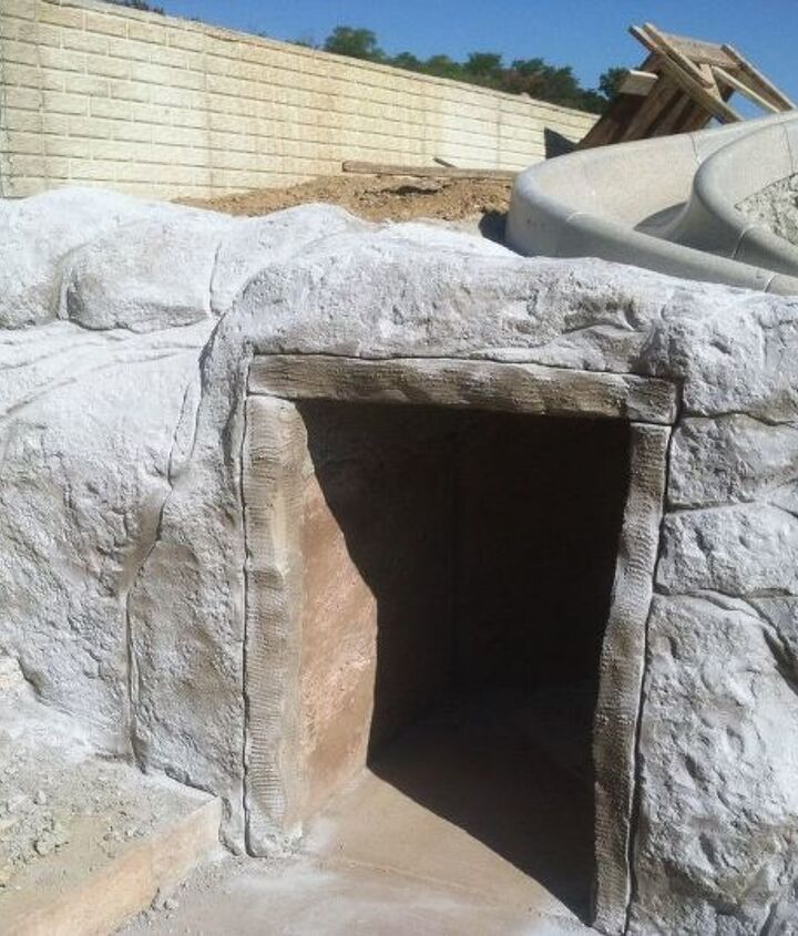 s 30 neat ideas to upgrade your backyard, Create this playful cave with a slide