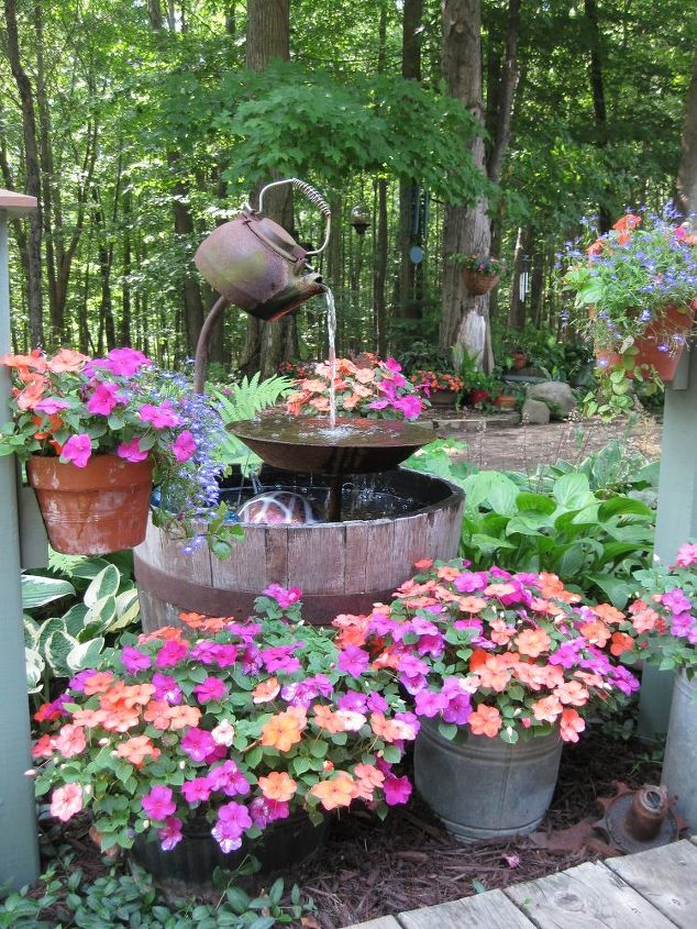 s 31 creative garden features perfect for summer, Upcycle a teapot into a rustic fountain