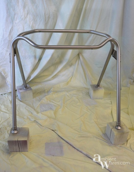 metal legs from a plastic chair become table legs