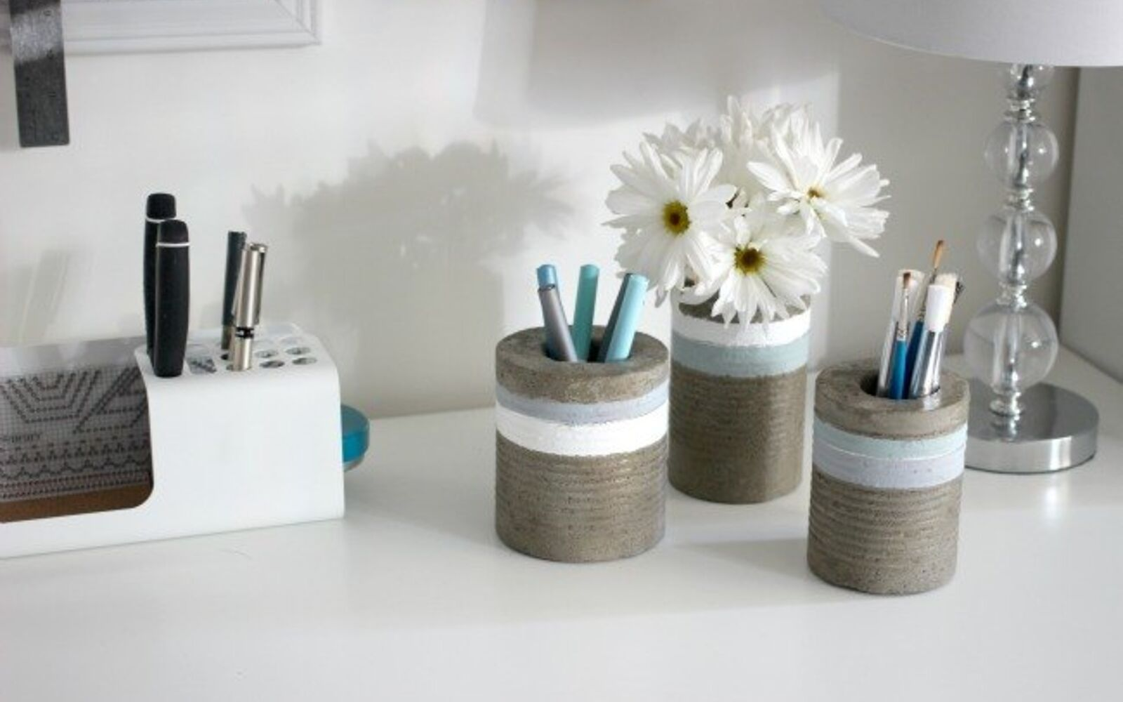 s 15 incredible vases you can make for your bestie on a budget, Mix Cement For A Concrete Vase