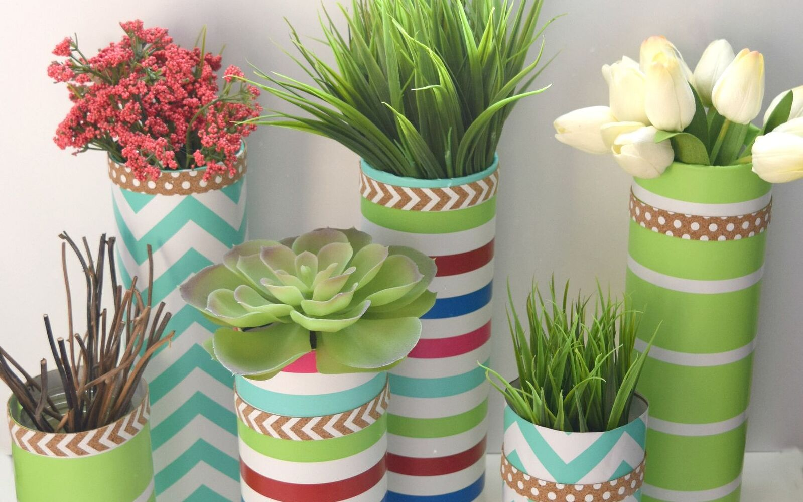 s 15 incredible vases you can make for your bestie on a budget, Use Colorful Decorative Wrapping Paper