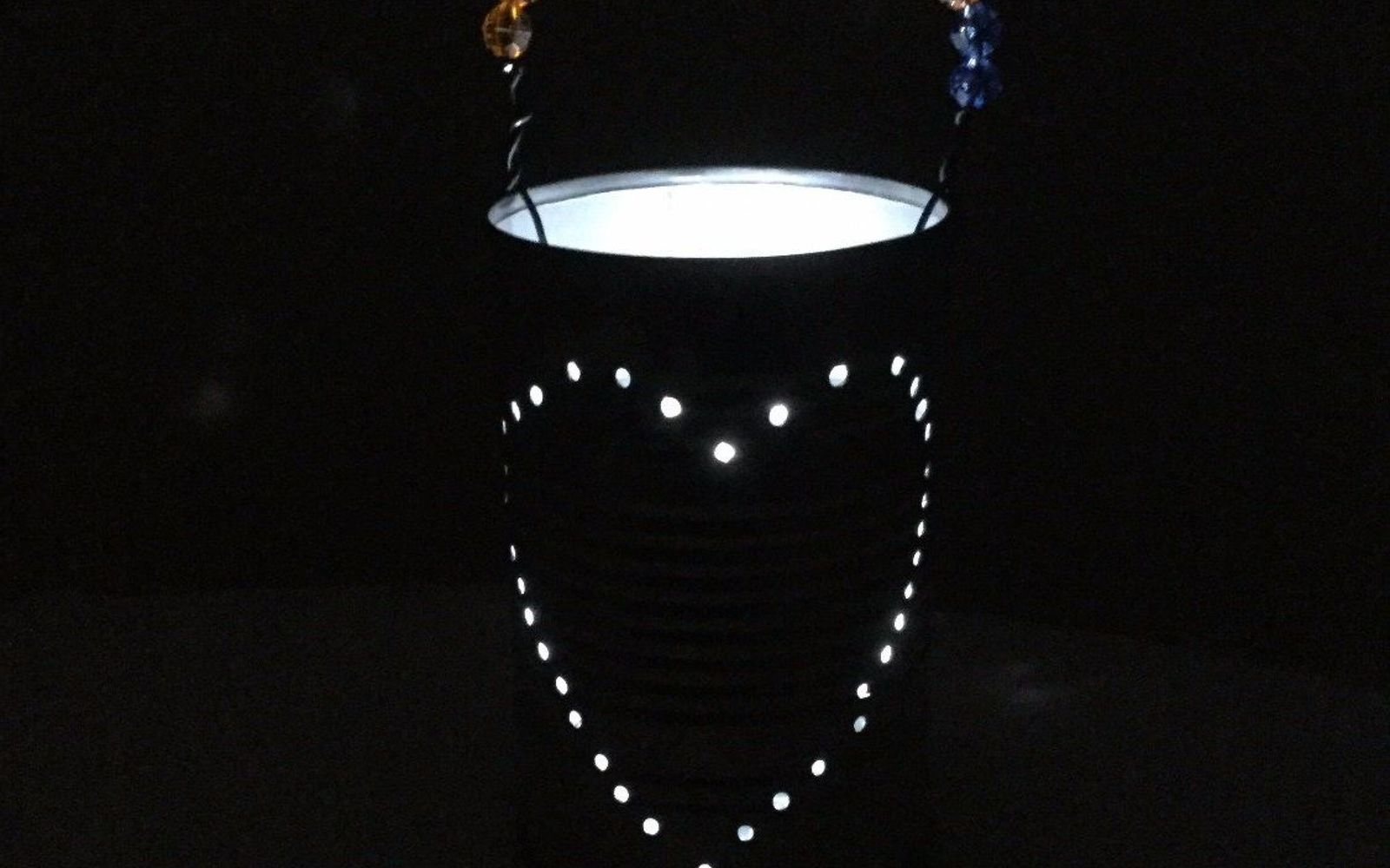 s 16 stunning ways for you to add solar lighting, Hammer A Nail Into A Tin Can