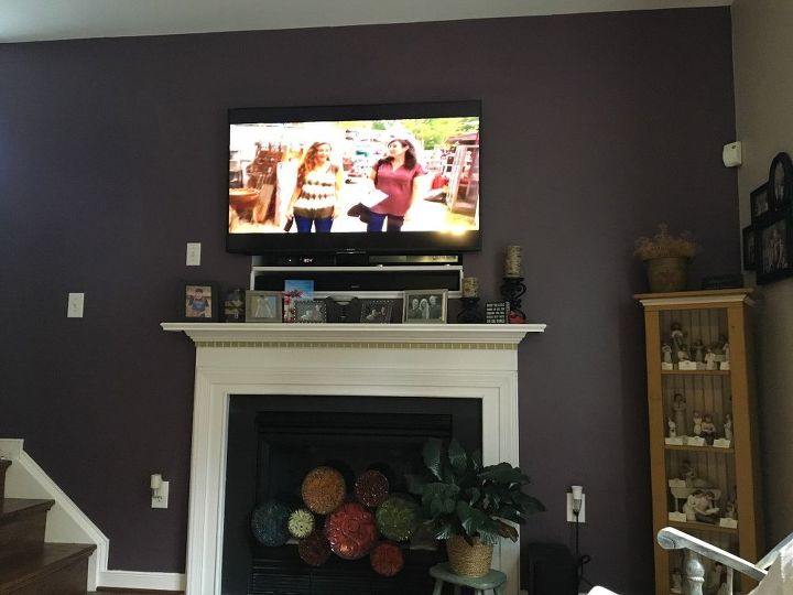 q want to add some flare above fireplace