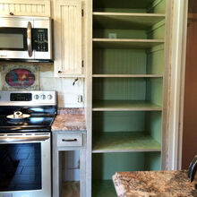 s 15 pinterest worthy pantries that eliminate search time for your favo, Spread Green Damask Paper On Shelves
