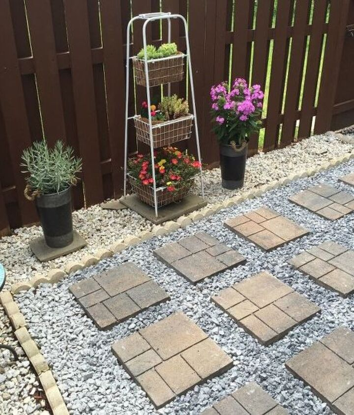 s 15 inexpensive tricks to help you landscape without stressing out, Pull Out Weeds For Paving Rocks