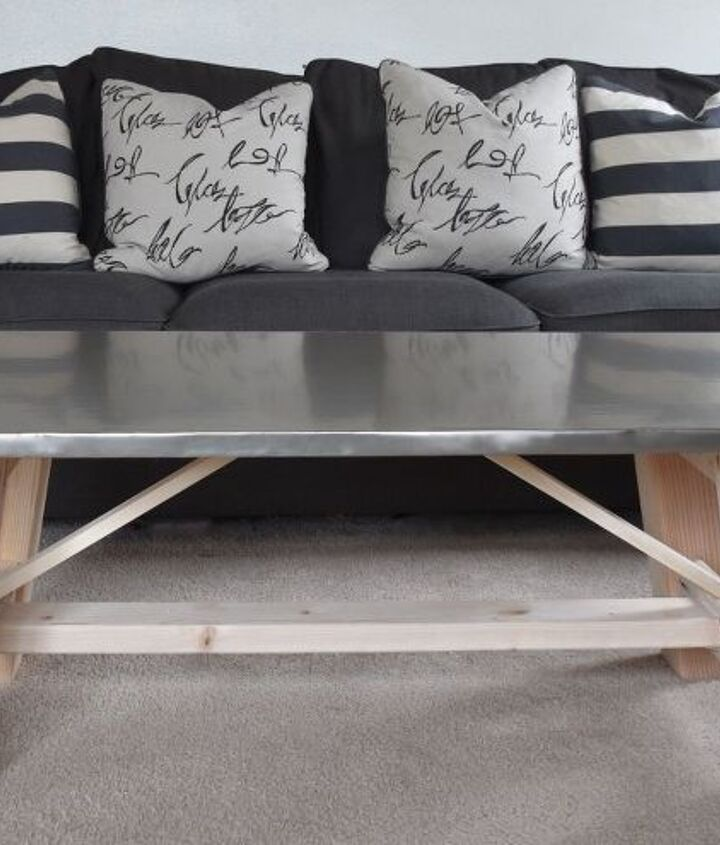 s 11 awesome projects to fake your way to the perfect home, Lay Film For A Metal Table