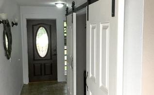 barn door hardware transforms ugly hallway