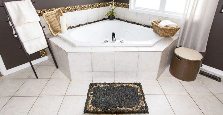 here s a gorgeous way to use river stones in your bathroom 14060