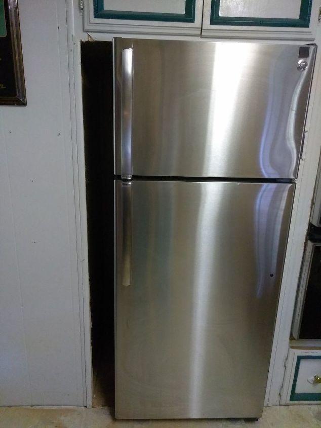 skinny shelf next to fridge gap