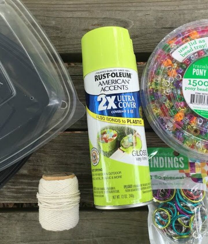 recycled salad container into a bird feeder