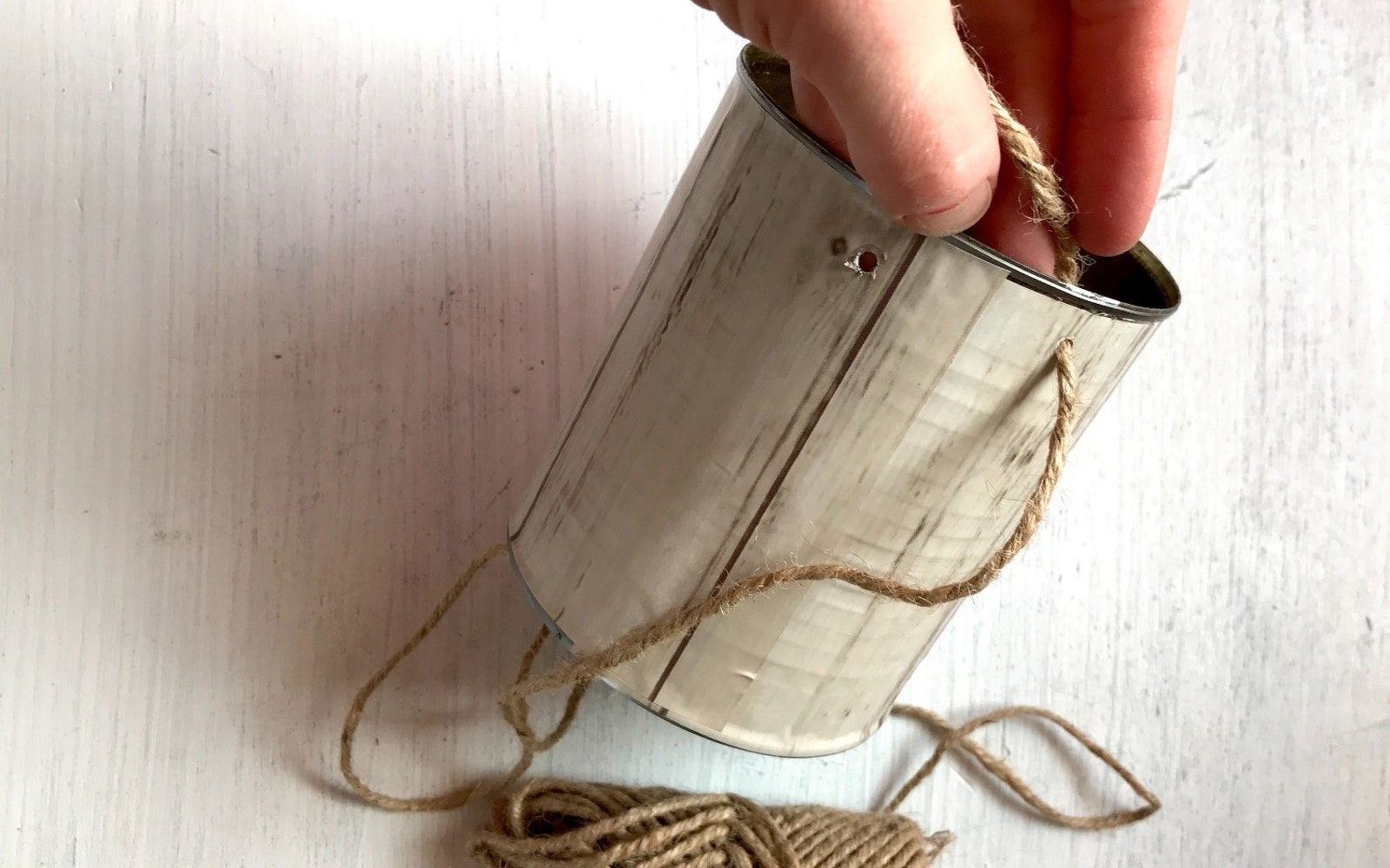 s transform tuna cans into gorgeous lighting in 9 simple steps, Step 5 Thread twine through the holes