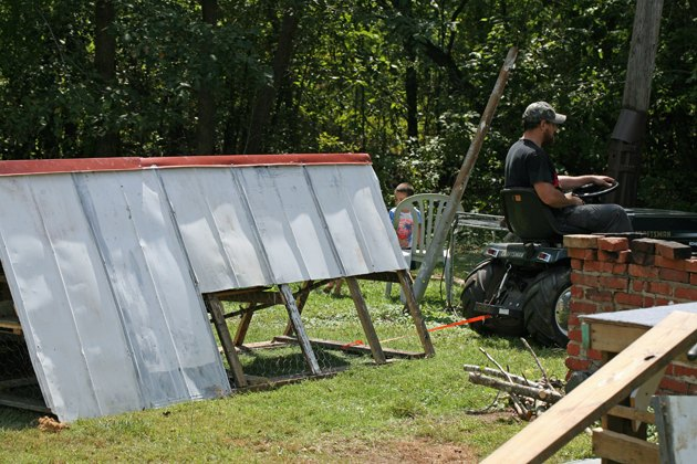 building a chicken tractor from scrap lumber and metal