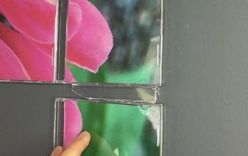 use your old cd cases for creative wall art