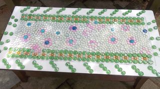 , i found this table on the side of the road painted the top and glued down marble tiles