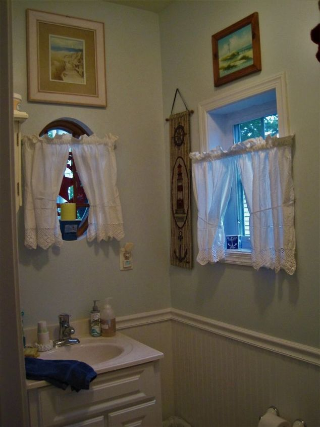 q how can i best decorate these windows in my powder room