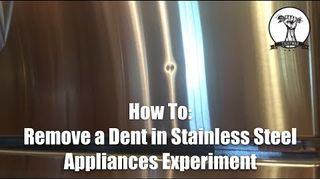 How can you remove small dents from a stainless steel
