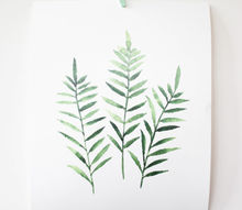 hanging botanical prints with clothes pins