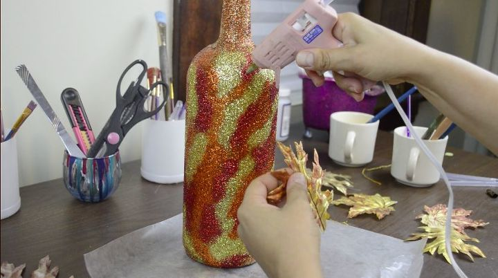 easy diy fall bottle decor with lots of glitter