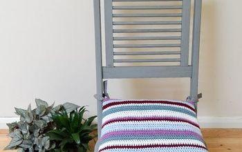 transform garden furniture with a bright striped crochet cushion