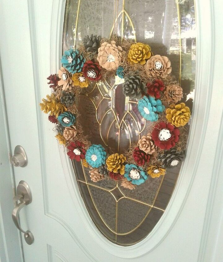 turn your dried out pine cones into a beautiful flower wreath