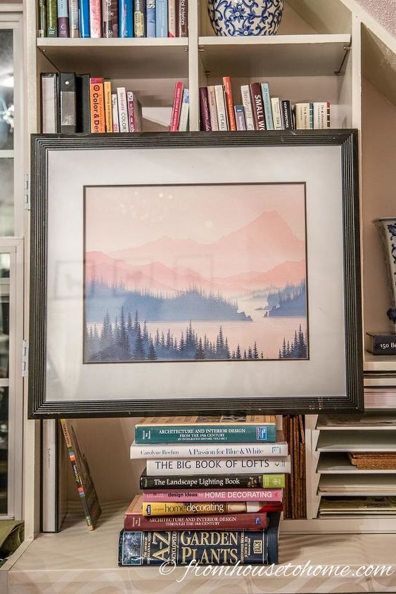 how to hang art on a bookshelf and still have easy access to the books