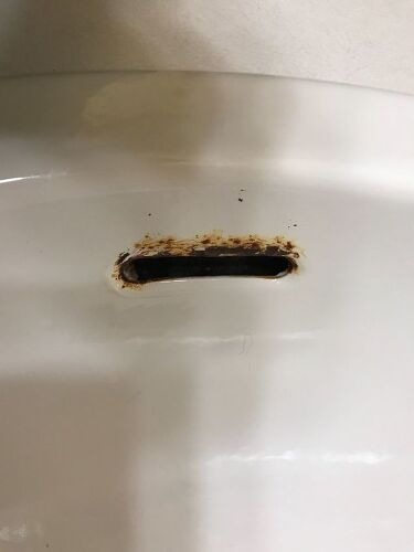 I have rust near the overflow hole on my bathroom sink. How do I fix ...