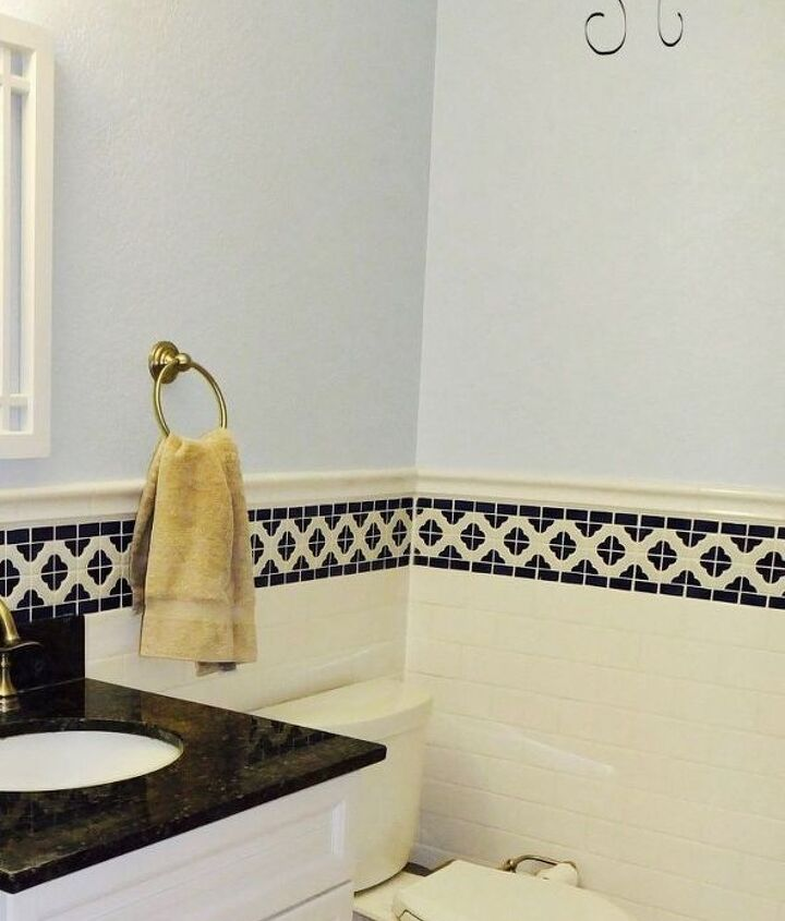 bathroom makeover with subway tile wainscoting before after