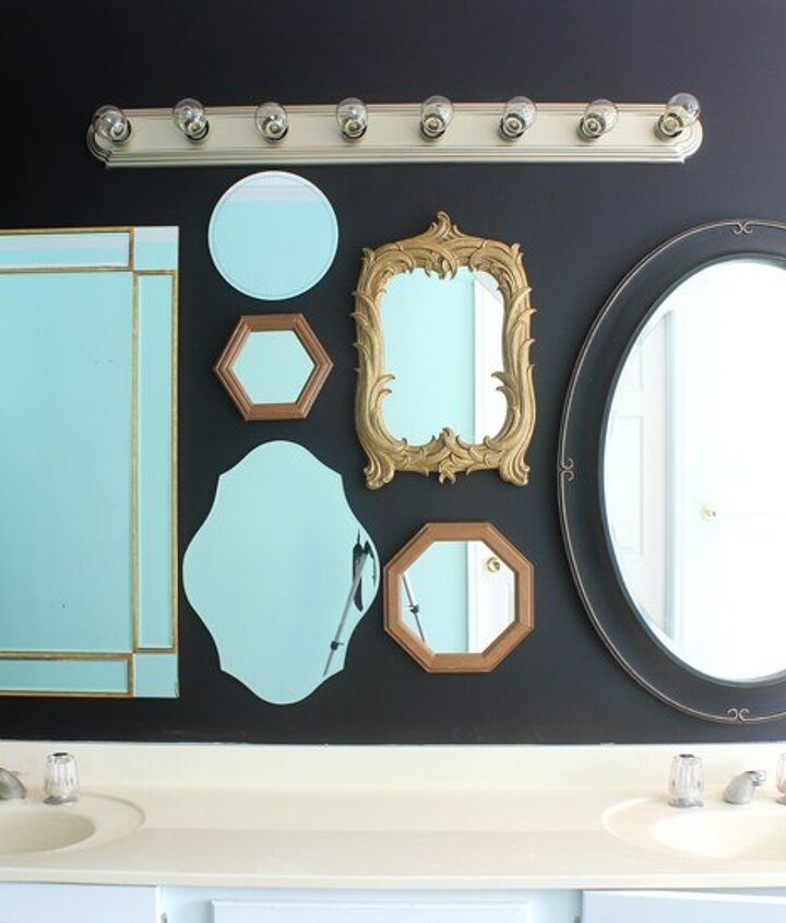 a wall of mirrors in the master bath