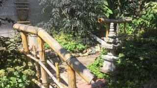 , The pagoda has acquired some moss and we added a bamboo railing