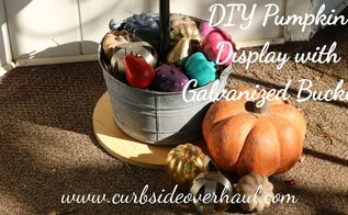 fall porch decoration with galvanized buckets