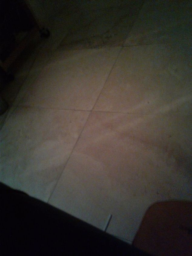 q how to get scratched up tile floor clean and polished