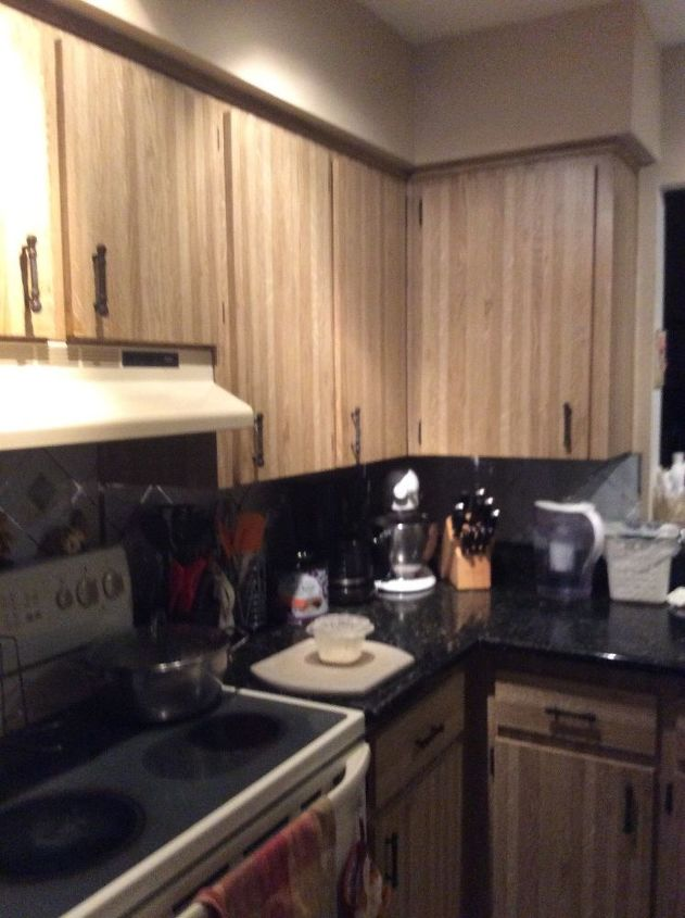 q how to paint an existing kitchen cabinet